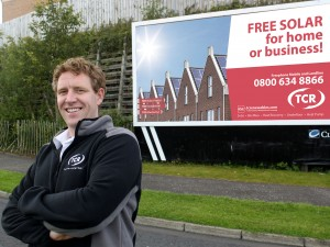 Pictured launching TCR's 'Free Solar Electricity' scheme is company director, John Adams.
